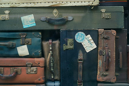 piled assorted-color suitcase