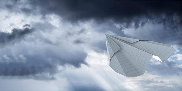 closeup photo of paper airplane