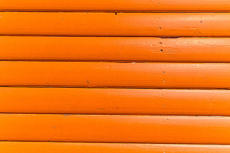 Close-up texture shot of bright orange wood panels. Image captured with a Canon DSLR