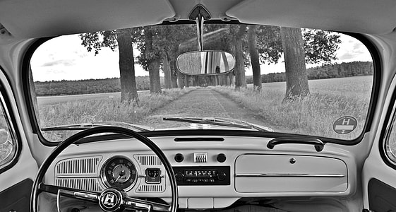 grayscale photo of car interior