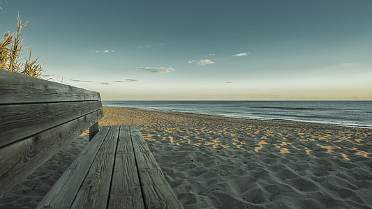 brown wooden bench in the beach
