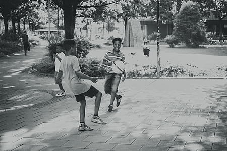 Grayscale Photography Of Kids Playing Ball