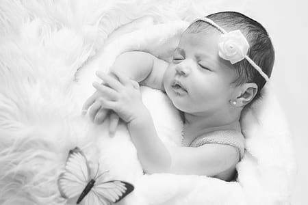 grayscale photo of baby sleeping