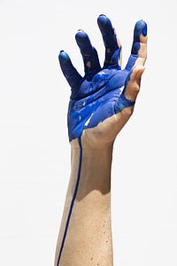 right arm with blue paint