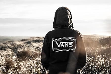 Photo Of Person Wearing Black Vans Hoodie