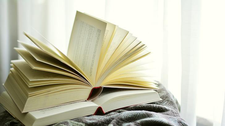 two open books inside room