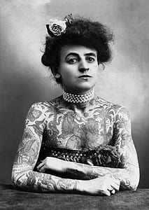 grayscale photograpy of woman covered with tattoo