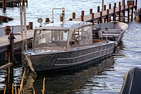 Product Photography of Silver Motor Boat Neck Dock during Daytime