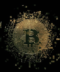 gold-colored Bitcoin coin