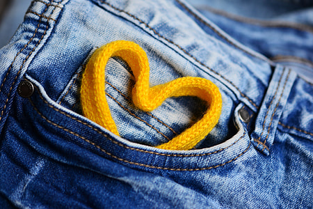 Pocket of denim jeans with love heart