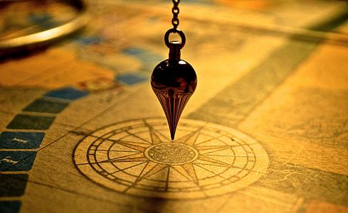 shallow focus on compass plum bob