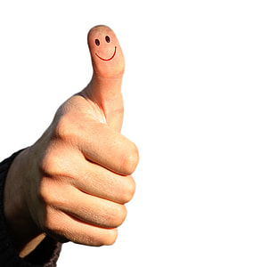 right person's thumb with smiley drawing