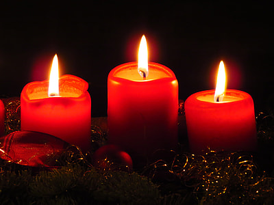 three red candles lighted