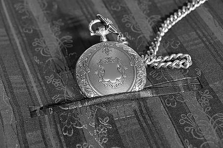round pocket watch with chain-link necklace