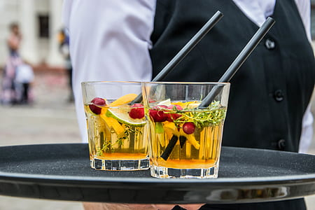 2 Whisky Glasses Filled With Beverage on Black Tray