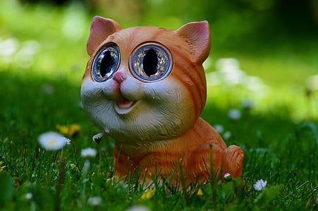 brown cat figurine