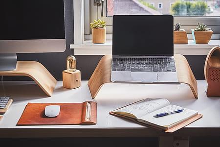 MacBook Pro beside book