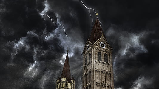 tower with lightning during night time