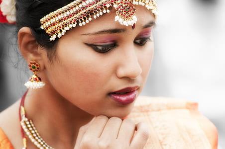closeup photo of woman putting hand on chin