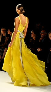 woman wearing yellow sleeveless long dress