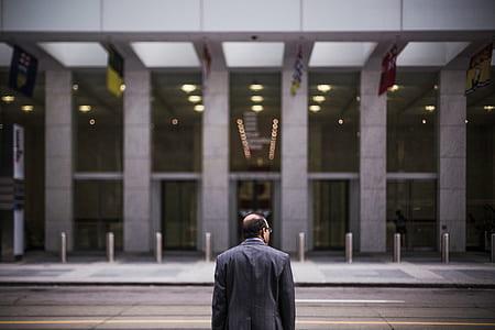 man in black coat in building