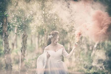 woman wearing white sweetheart-neckline wedding gown