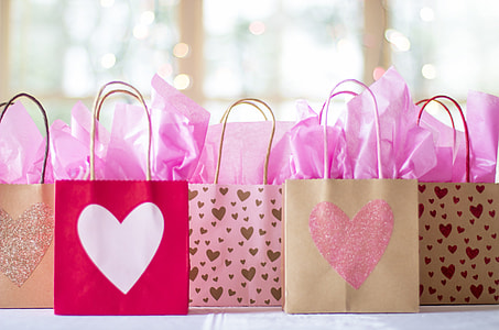 brown and red heart print paper bags