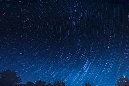 Stars trail in the night sky