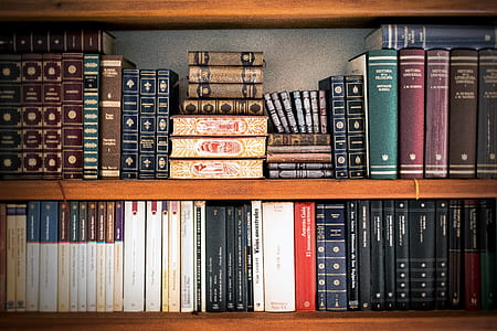 books on brown wooden shelf