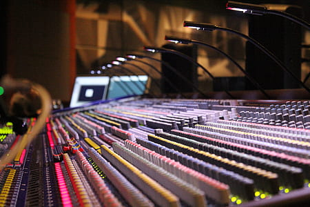 closeup photo of audio mixers