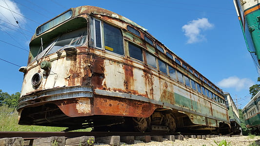 rusted white and gray train