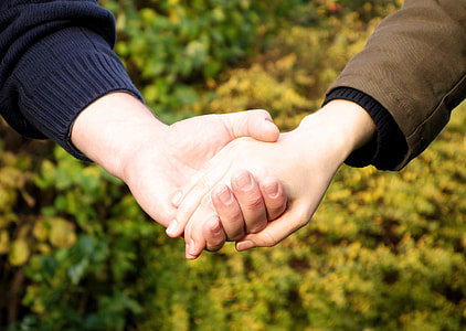 man and woman holding hands photograph