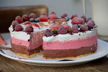 serve plate of cake with strawberry toppings
