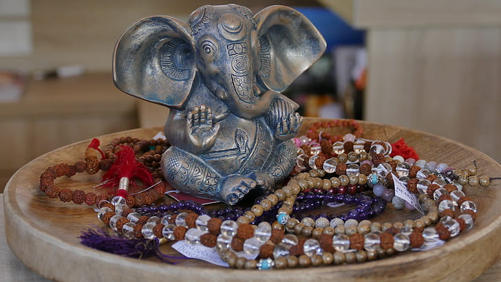 selective focus photography Ganesha figurine