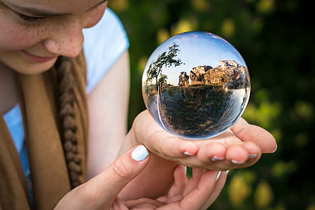women holding clear glass globe