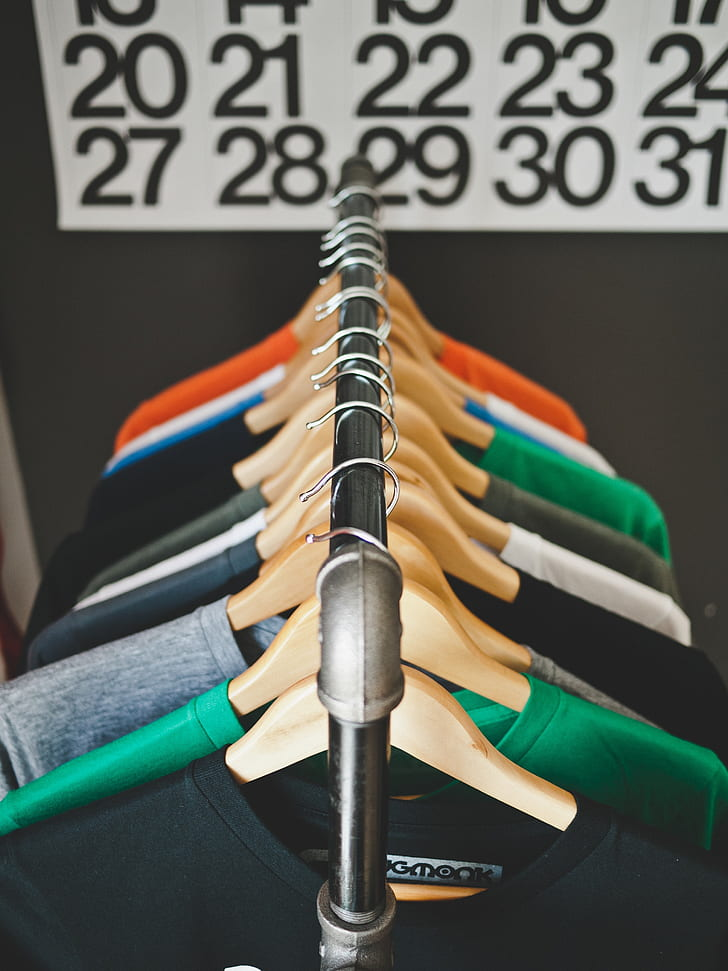 selective focus photography of hanged scoop neck shirts