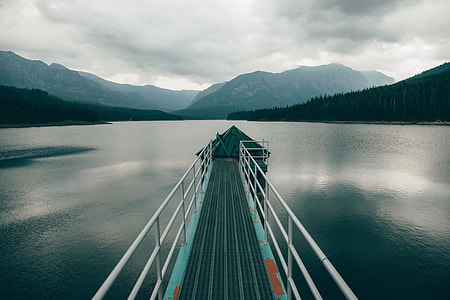 photography of teal and white metal dock