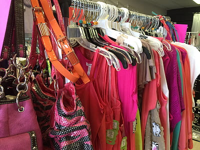 assorted-color dresses hanged on silver clothes rack