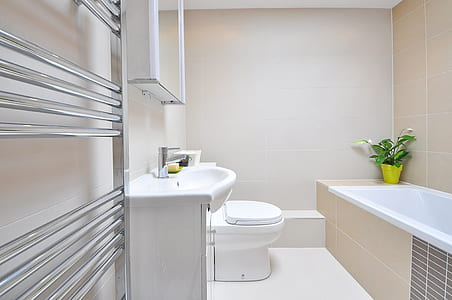 white ceramic sink and toilet bowl with white painted wall