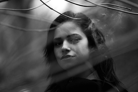 gray scale photo of woman in black shirt