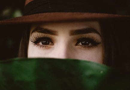 woman hiding on green leaf photography