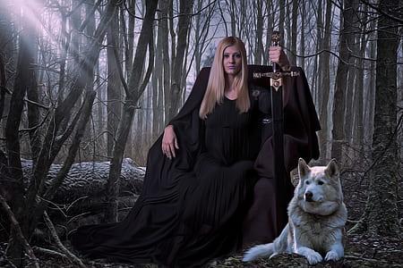 woman wearing black dress holding sword sitting beside white Siberian husky dog