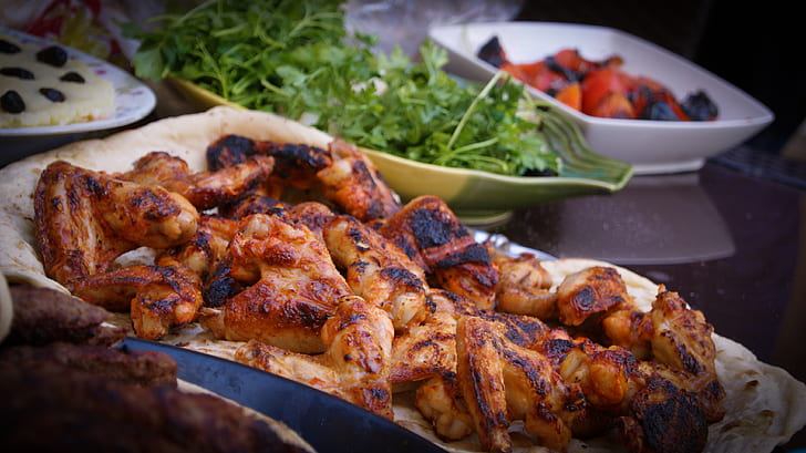 grilled chicken on tray