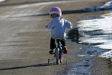 girl ride on bike on road