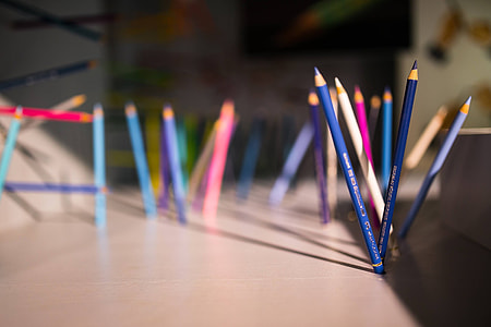 Pencils and crayons sticking out of the walls and floors