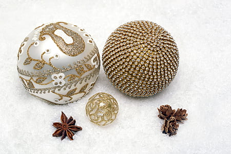 three brown and white metal clear gemstone encrusted decorative balls
