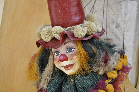 red and yellow clown figurine