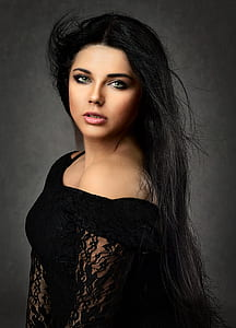 woman wearing black floral dress