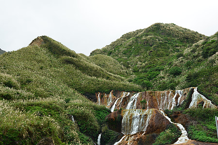 waterfalls near mountain