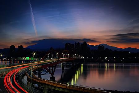 Light Rays on Bridge during Nighttime